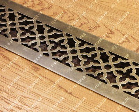 Алюминиевая решетка в подоконник с обработкой под состаренную латунь